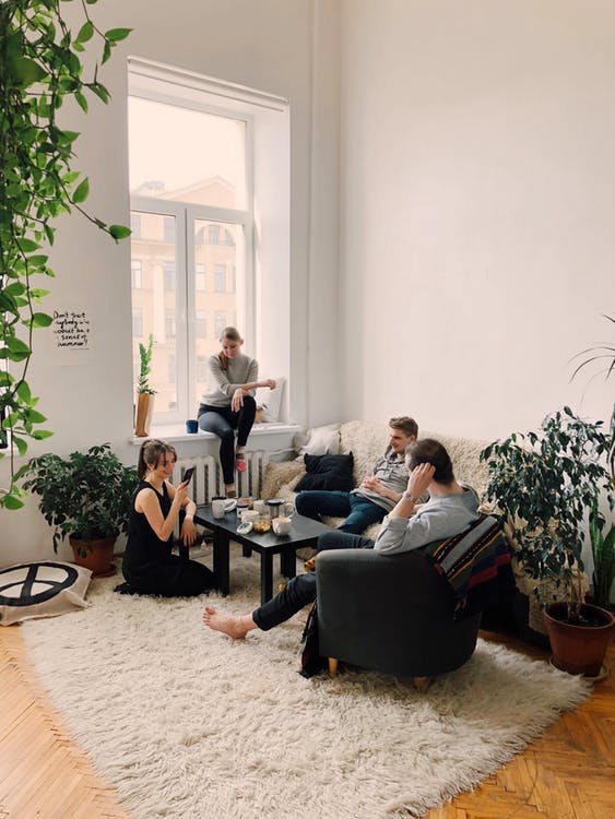 Two guys and two girls in a living room