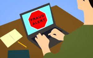 Fraud alert on a laptop screen.
