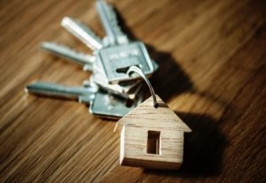 key chain with wooden home