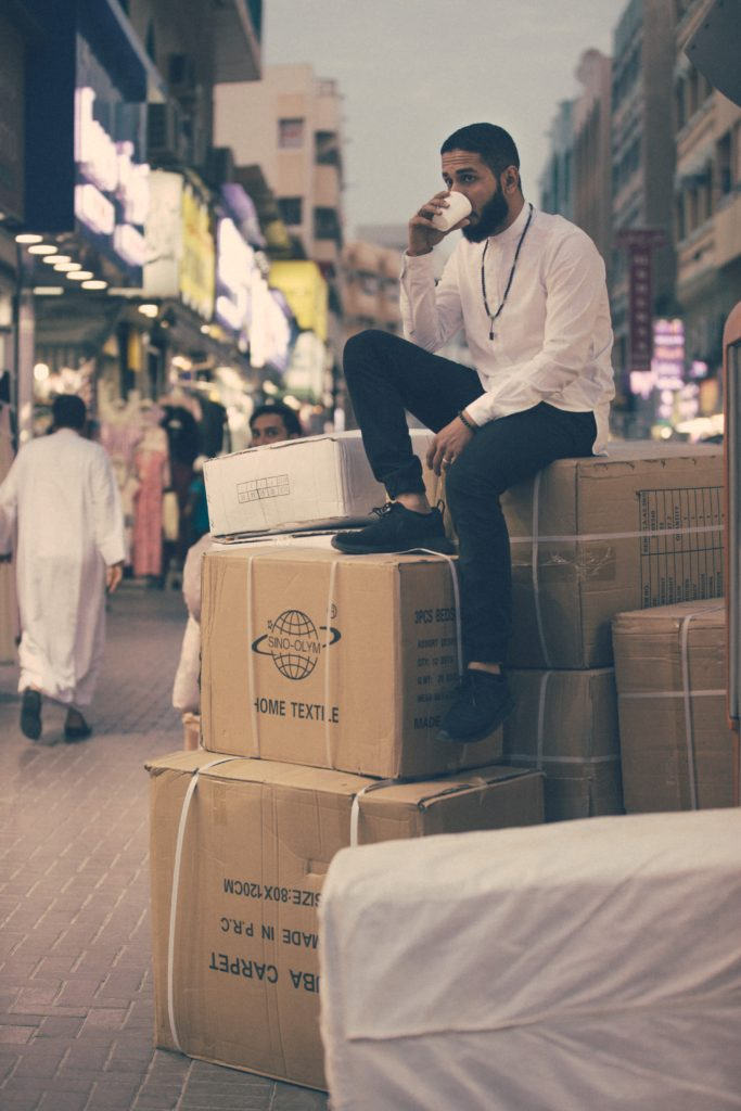 Man sitting on boxes