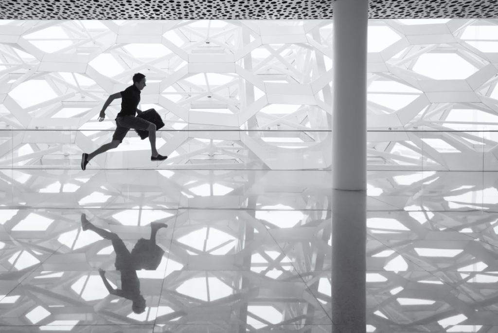 Man running, rushing to pack for a move