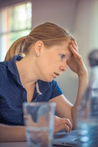 Stressed women because if surviving Florida on a tight budget