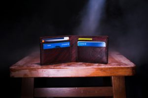An opened wallet with credit cards inside