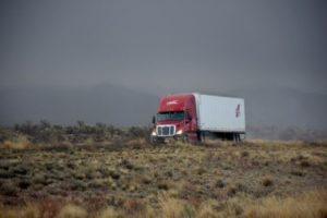 a truck driving through a field