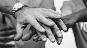 Friends putting hands on one another