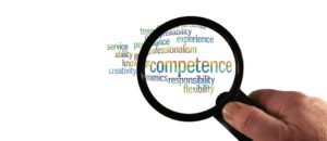 A magnifying glass looking at competence needed to hire reliable movers.