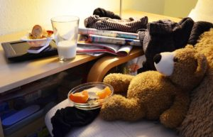 A messy room. You don't want your room to look like this, so start decluttering your NYC apartment as soon as possible.