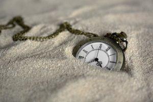 A clock in sand.
