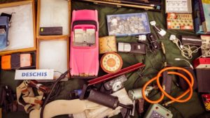 various items for a garage sale which is a perfect solution when you want to declutter before moving