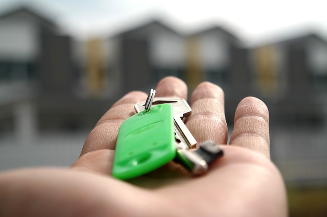 Keys offered to a person moving to a smaller apartment