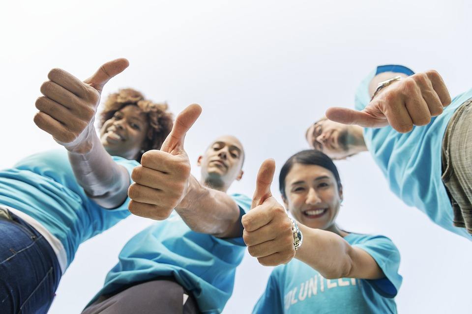 A group of people showing thumbs up for all technical innovations in the moving industry.