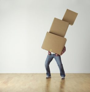 A man carrying cardboard boxes.