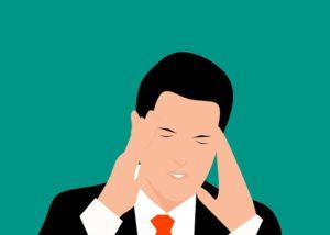 An illustration of a businessman with a headache.