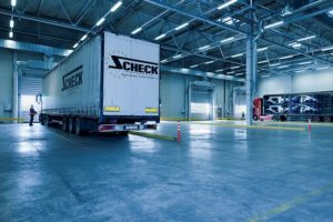 Trucks in a warehouse ready for any logistical task.