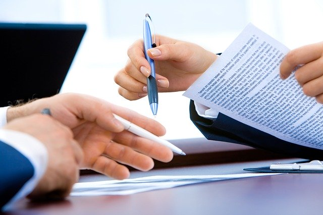 Signing a document to transfer utilities when moving.