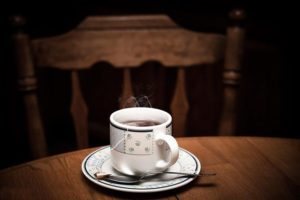 A cup of tea on a wooden table.