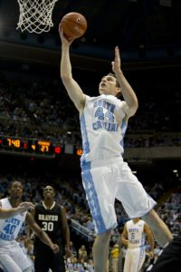 North Carolina University basketball player going in for a layup during a game.