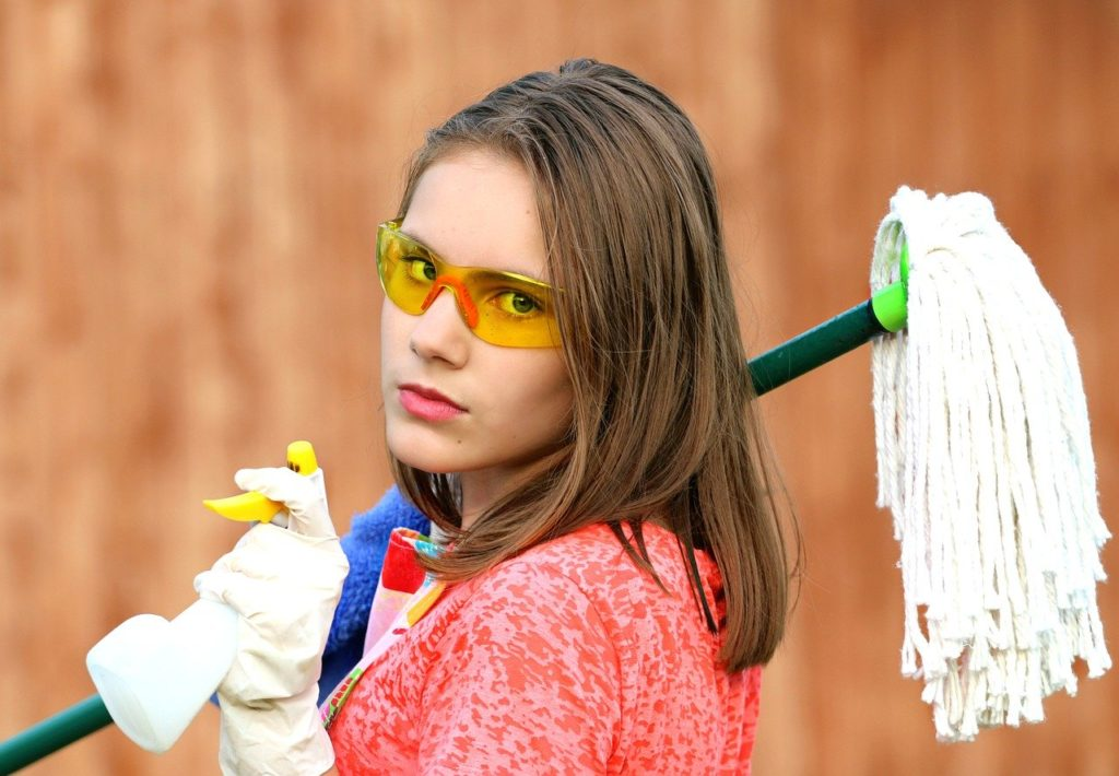 Cleaning lady that is a reason to pay for cleaning services when moving