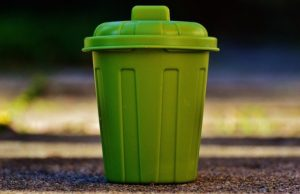 A green garbage can.
