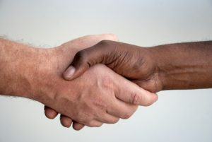 A handshake with a company's representative after renting a moving truck for your move.