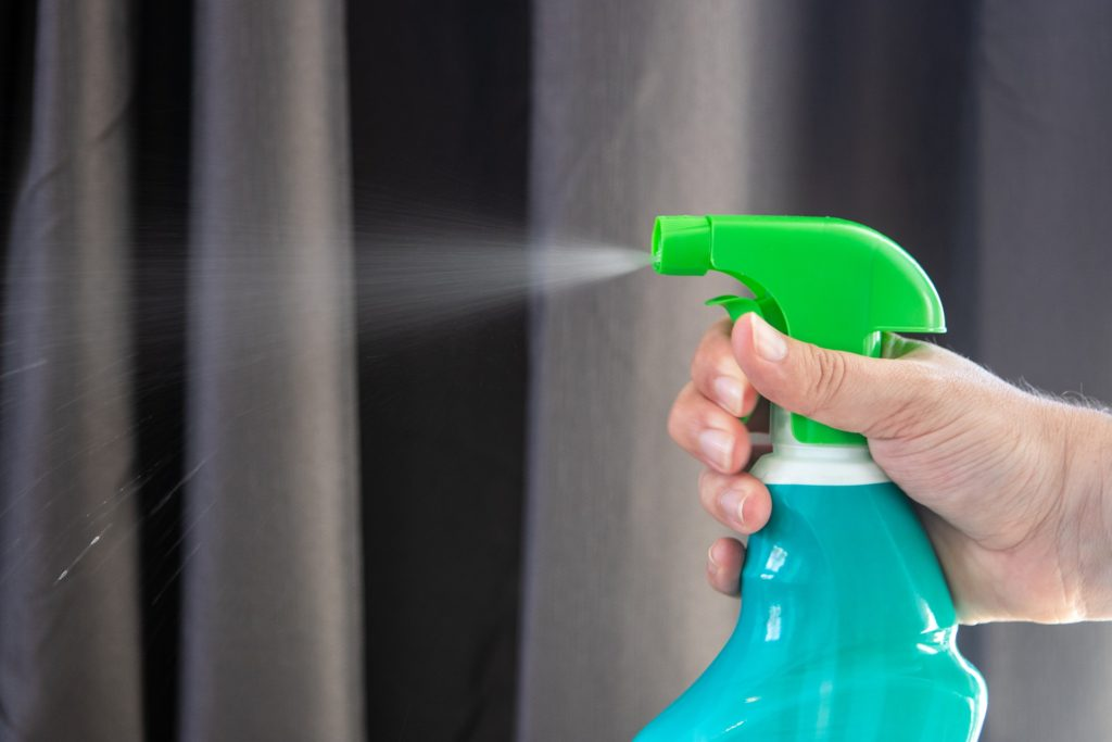 spray bottle with pesticides used to kill common house bugs