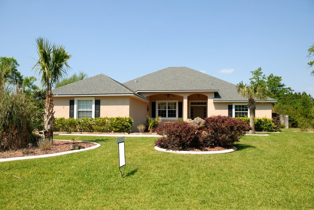 One of the beautiful houses with plenty of greenery to consider when moving locally in Florida.