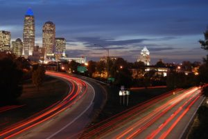 Skyline and car trails in Charlotte - beautiful cities are one of the reasons why people love North Carolina