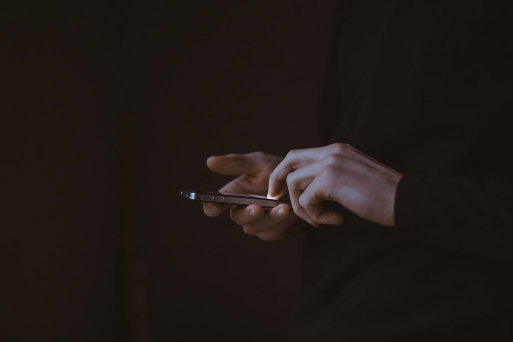 A man holding a mobile phone.