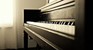There is a black and white picture of a piano.
