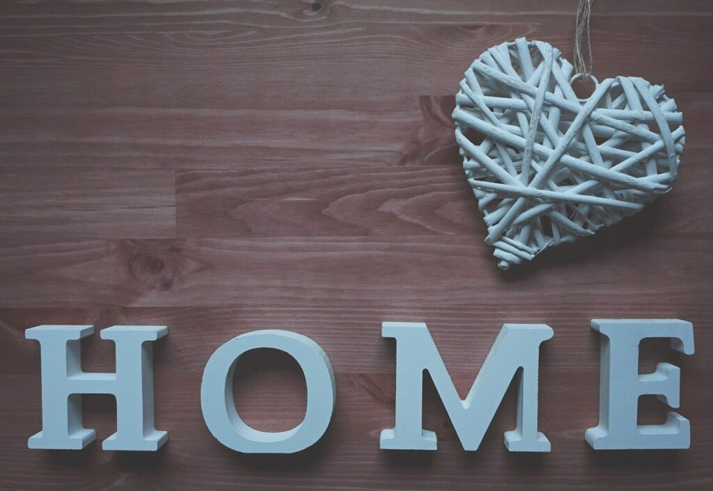 The word home written in decorative wooden letters