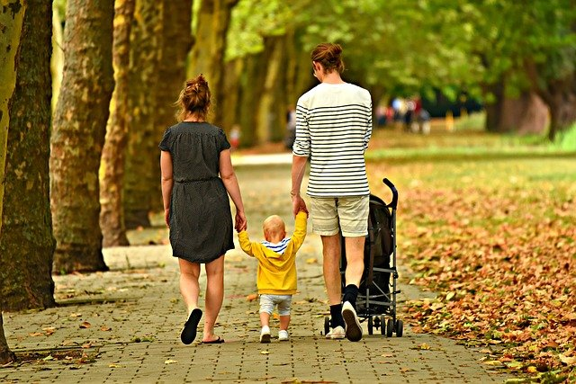 Parents walking their child in a park
