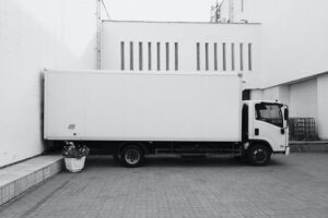 A parked moving white moving truck.