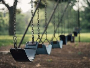 Swings in a park.