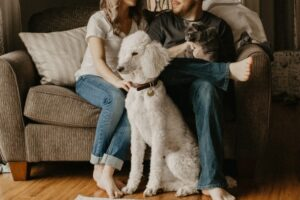 A couple and their pets settling in their home in one of many family-friendly cities in Louisiana.
