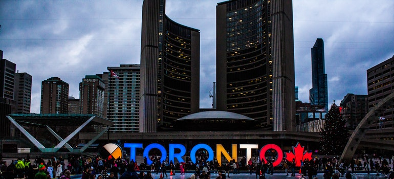 People gathered in front of Toronto sign