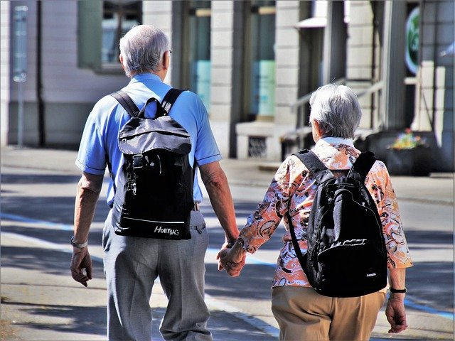 Two seniors who are buying their first house taking a walk