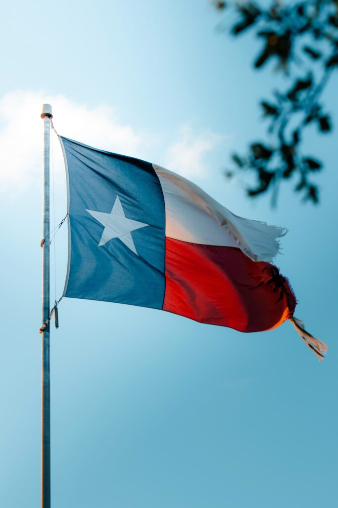 an image of a Texas flag, read about buying a house in Burleson, Texas