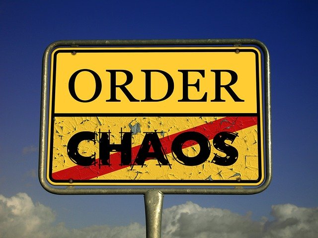 Order and chaos street sign.
