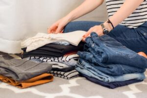 a person folding clothes, read about Tips for moving into your dream home in Quantico