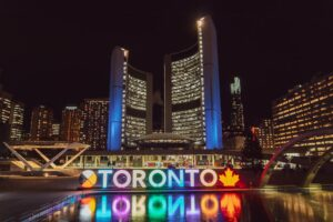 Multicolored Toronto sign lit up during the night in Toronto.